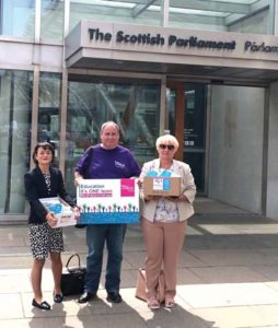 (Johanna Baxter, Mark Ferguson, local government chair, and vice chair Carol Ball take the postcards to the Parliament.)